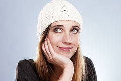 Woman with a winter cap looking up Royalty Free Stock Image
