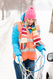 Woman winter car problems tire chains Royalty Free Stock Image