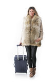 Woman in winter cl with a rolling suitcasothese. Stock Photos