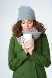 Woman in winter cloth holding cup with coffee Stock Photos