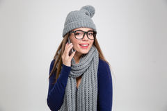 Woman in winter cloth talking on the phone Stock Photo