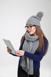Woman in winter cloth using tablet computer Stock Images
