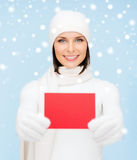 Woman in winter clothes with blank red card Stock Images