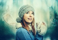 Woman in winter clothes drinking coffee Royalty Free Stock Photo