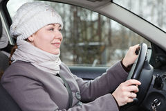 Woman in winter clothes driving car Stock Photography