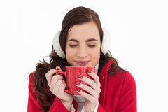 Woman in winter clothes enjoying a hot drink eyes closed Royalty Free Stock Photos
