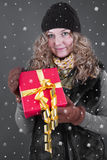 Woman in winter clothes with gift box for christmas Royalty Free Stock Photos