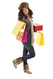 Woman in winter clothes with gifts shopping bags Stock Photo