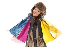 Woman in winter clothes with gifts & shopping bags Stock Photo