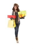 Woman in winter clothes with gifts & shopping bags Stock Photography