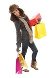 Woman in winter clothes with gifts & shopping bags Stock Photos