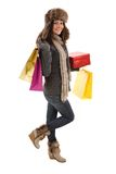 Woman in winter clothes with gifts & shopping bags Royalty Free Stock Photo