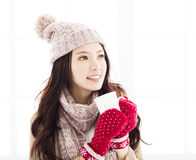 Woman in winter clothes having hot drink Royalty Free Stock Photography