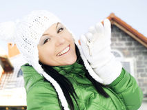 Woman in winter clothes holding keys Stock Photo