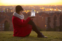 Woman on winter clothes holding a led lights lantern Royalty Free Stock Photography