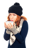 Woman in winter clothes holding mug with hot drink Stock Image