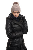 Woman in winter clothes and knit hat Stock Images