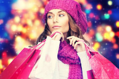 Woman in winter clothes with pink shopping bags Royalty Free Stock Photography