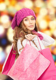 Woman in winter clothes with pink shopping bags Royalty Free Stock Images