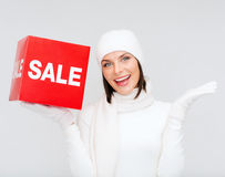 Woman in winter clothes with red sale sign Stock Photo