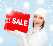 Woman in winter clothes with red sale sign Royalty Free Stock Photography
