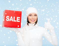 Woman in winter clothes with red sale sign Stock Photos