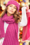 Woman in winter clothes with shopping bags. Holidays, sale, christmas concept - beautiful woman in winter clothes with shopping bags Royalty Free Stock Images