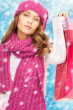 Woman in winter clothes with shopping bags Stock Images