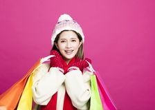 Woman in winter clothes and shopping for christmas gifts. Happy Woman in winter clothes and shopping for christmas gifts Stock Image