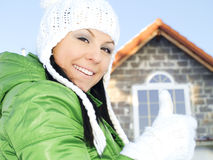Woman in winter clothes showing ok sign Royalty Free Stock Photo