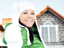 Woman in winter clothes showing ok sign in front o Royalty Free Stock Photos