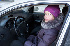 Woman in winter clothes sitting in car Royalty Free Stock Photography
