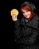 Woman in winter clothes with tasty cake Royalty Free Stock Photos