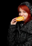 Woman in winter clothes with tasty cake Stock Photo