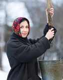 Woman in winter clothes at  well Royalty Free Stock Photo