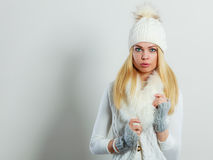 Woman in winter clothes woolen cap fur scarf Royalty Free Stock Photo