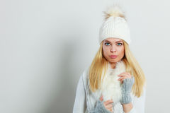 Woman in winter clothes woolen cap fur scarf Stock Photography