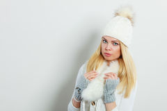 Woman in winter clothes woolen cap fur scarf Stock Photo
