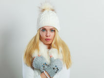 Woman in winter clothes woolen cap fur scarf Royalty Free Stock Images
