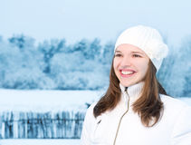 Woman in winter clothing Stock Images