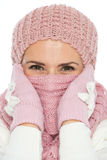 Woman in winter clothing closing face with scarf Stock Photos
