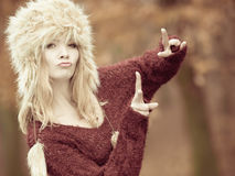 Woman in winter clothing fur cap Royalty Free Stock Images
