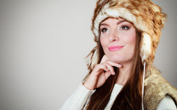 Woman in winter clothing fur cap Stock Images