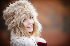 Woman in winter clothing fur cap outdoor Royalty Free Stock Photo