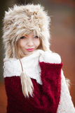 Woman in winter clothing fur cap outdoor Stock Photo