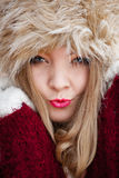Woman in winter clothing fur cap outdoor Stock Images