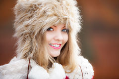 Woman in winter clothing fur cap outdoor Stock Photography