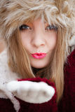 Woman in winter clothing fur cap outdoor Royalty Free Stock Images