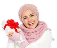 Woman in winter clothing holding Christmas gift Royalty Free Stock Photography