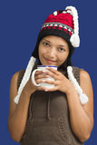 Woman in winter clothing holding a cup Royalty Free Stock Photo